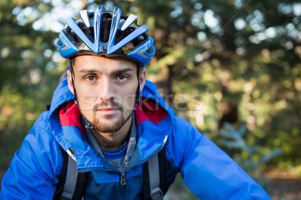 Portrait of male mountain biker in the forest Stock photo © wavebreak_media