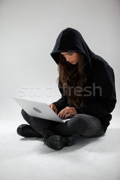 Hacker using a laptop Stock photo © wavebreak_media