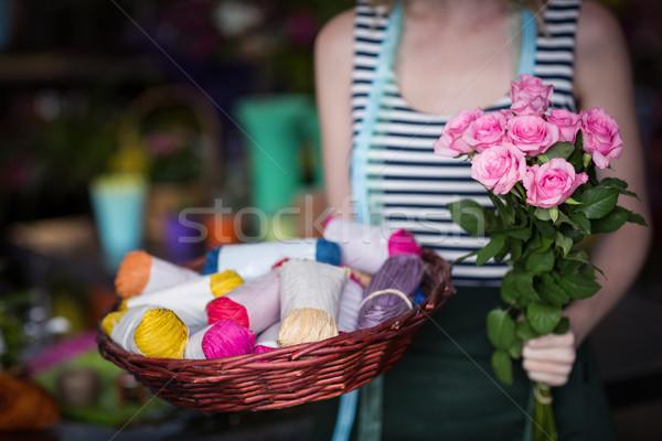 Female florist holding bunch of flower in flower shop Stock photo © wavebreak_media