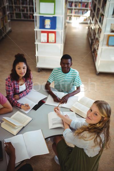 Magasról fotózva kilátás boldog osztálytársak tanul könyvtár Stock fotó © wavebreak_media