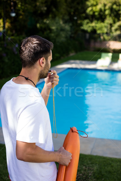 Lifeguard blowing whistle at poolside Stock photo © wavebreak_media