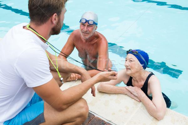 Nager coach chronomètre couple de personnes âgées femme Photo stock © wavebreak_media