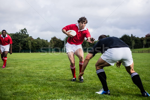 Rugby players tackling during game Stock photo © wavebreak_media
