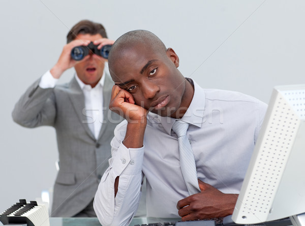Ethnic businessman getting bored and his manager looking through Stock photo © wavebreak_media