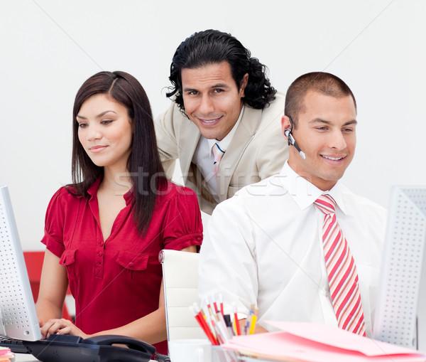 Atractivo gerente trabajo en equipo oficina mujer mujeres Foto stock © wavebreak_media