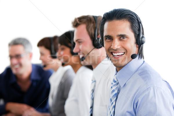 Souriant gens d'affaires travail centre d'appel ordinateur visage Photo stock © wavebreak_media