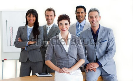 Cheerful business people around a conference table Stock photo © wavebreak_media