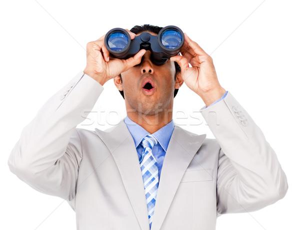Sorpreso imprenditore guardando binocolo isolato bianco Foto d'archivio © wavebreak_media
