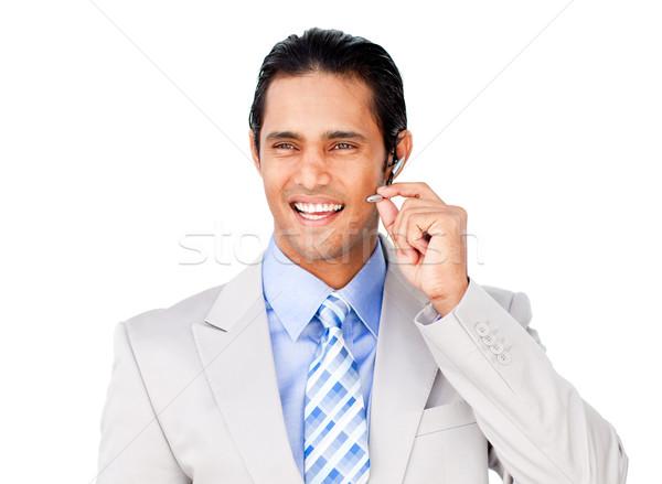 Confident businessman with headset on Stock photo © wavebreak_media