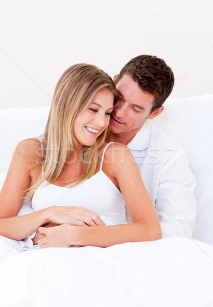 Portrait of a loving couple sitting on bed Stock photo © wavebreak_media