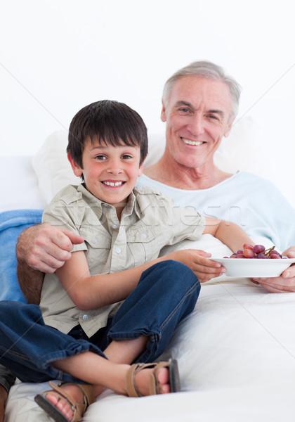 Cute little boy taking care of his grandfather Stock photo © wavebreak_media