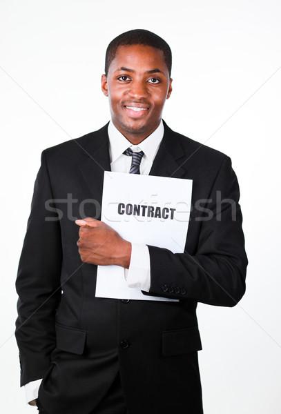 Happy businessman holding a contract  Stock photo © wavebreak_media