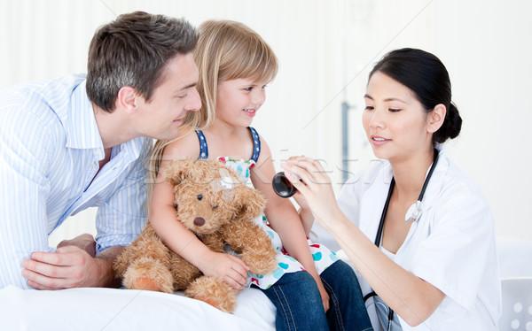 Concentrated female doctor giving syrup to a little girl Stock photo © wavebreak_media