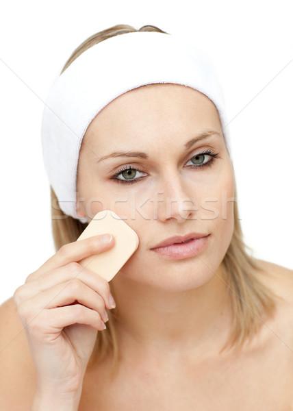 Beautiful woman putting make-up Stock photo © wavebreak_media