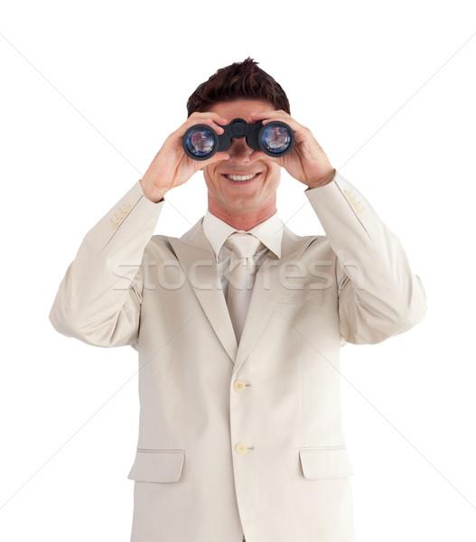 Confident businessman with binoculars Stock photo © wavebreak_media