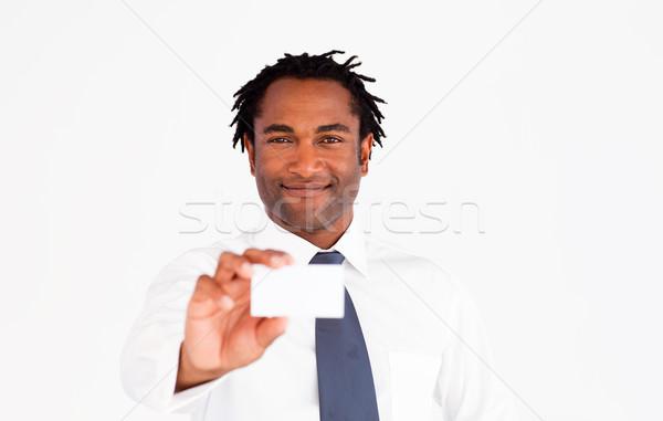 Portrait of afro-american businessman holding white card  Stock photo © wavebreak_media