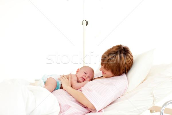 Patient speaking to her newborn baby in bed Stock photo © wavebreak_media