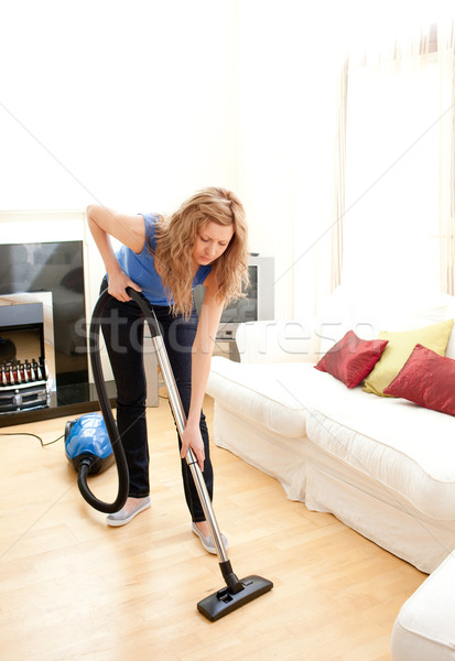 Disintersest woman cleaning a living room with a vacuum cleaner Stock photo © wavebreak_media