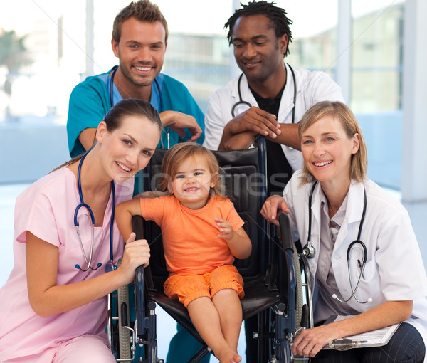 группа врачи ребенка коляске улыбаясь камеры Сток-фото © wavebreak_media