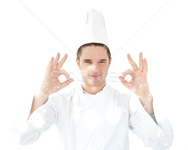 Cook giving hand signal against white background Stock photo © wavebreak_media
