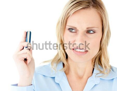 Mérges tart mobiltelefon néz oldal fehér Stock fotó © wavebreak_media
