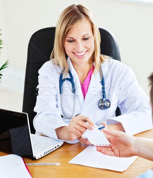 Woman doctor giving notice to her male patient  Stock photo © wavebreak_media
