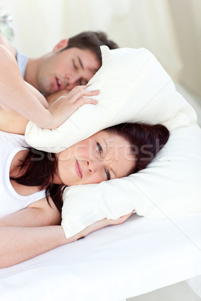 Young woman annoyed by the snores of her boyfriend in the bedroom Stock photo © wavebreak_media