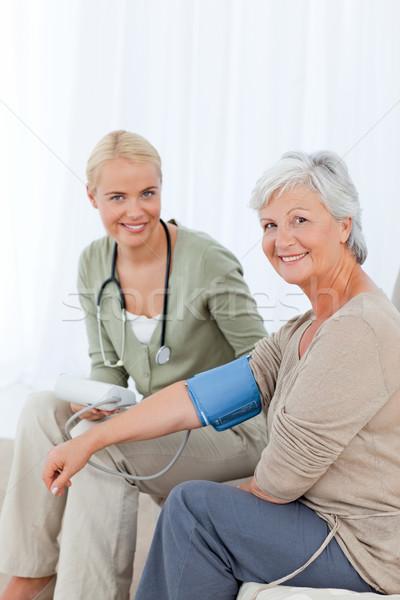 Medico pressione sanguigna paziente famiglia mano Foto d'archivio © wavebreak_media