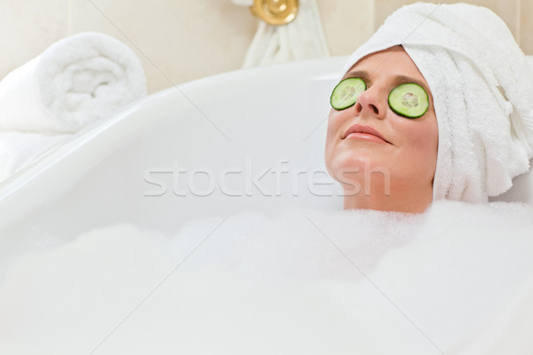 Relaxed woman taking a bath with a towel on her head Stock photo © wavebreak_media