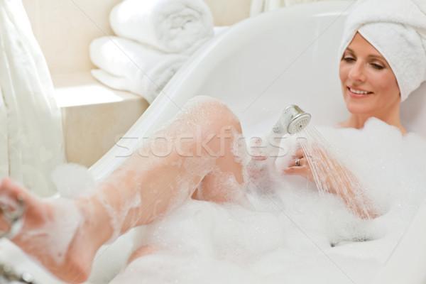 Femme souriante bain serviette tête yeux Photo stock © wavebreak_media