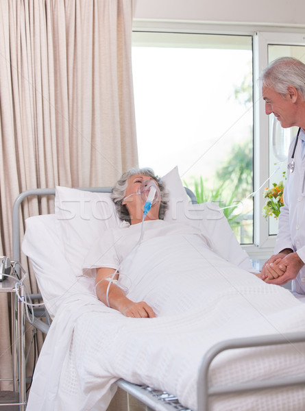 Senior doctor with his sick patient Stock photo © wavebreak_media