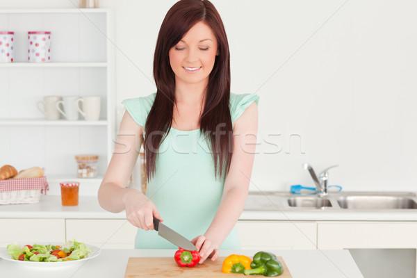 Vonzó nő vág zöldségek konyha gyümölcs Stock fotó © wavebreak_media