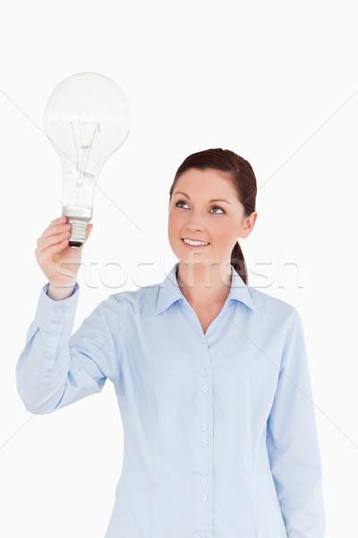 Aantrekkelijk vrouwelijke gloeilamp permanente witte Stockfoto © wavebreak_media