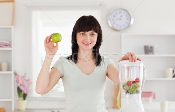 Charming brunette female posing while standing in the kitchen Stock photo © wavebreak_media