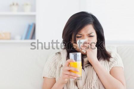 sad woman with orange juice in livingroom Stock photo © wavebreak_media