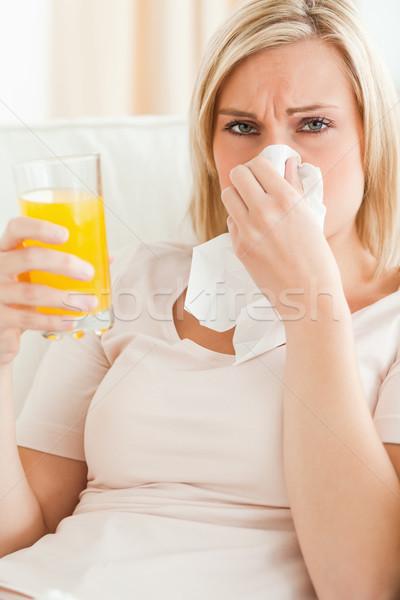 Portrait of a sick blonde woman in her living room Stock photo © wavebreak_media