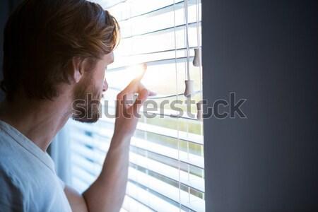 Femme sur fenêtre bureau visage cheveux Photo stock © wavebreak_media