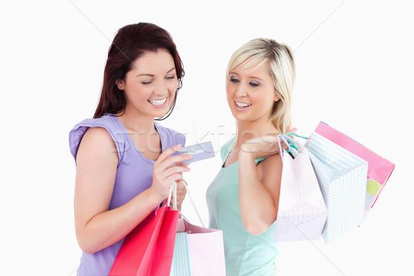 Zdjęcia stock: Wesoły · kobiet · karty · studio · uśmiech