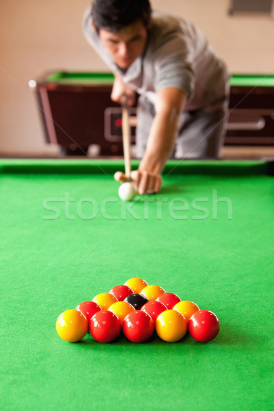 Portrait of a man playing snooker with the camera focus on the balls Stock photo © wavebreak_media