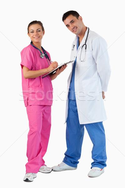 肖像 医師 話し 看護 メモを取る 白 ストックフォト © wavebreak_media