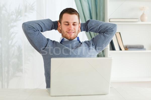 Genç işadamı geri yaslanarak iş bilgisayar ev Stok fotoğraf © wavebreak_media