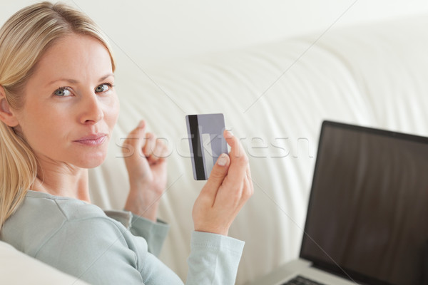 Back view of young woman shopping online Stock photo © wavebreak_media