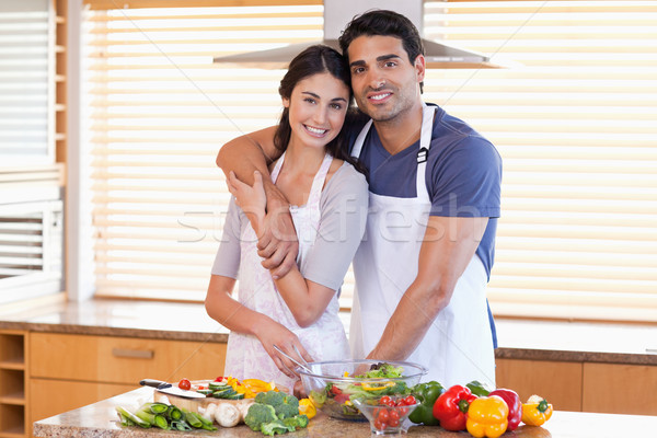 Charming young couple posing in their kitchen Stock photo © wavebreak_media