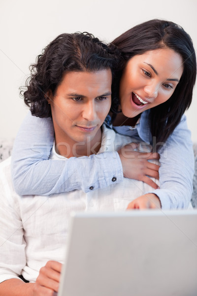 Young couple spending time online together Stock photo © wavebreak_media