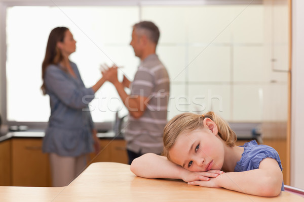 Sad girl hearing her parents arguing in a kitchen Stock photo © wavebreak_media