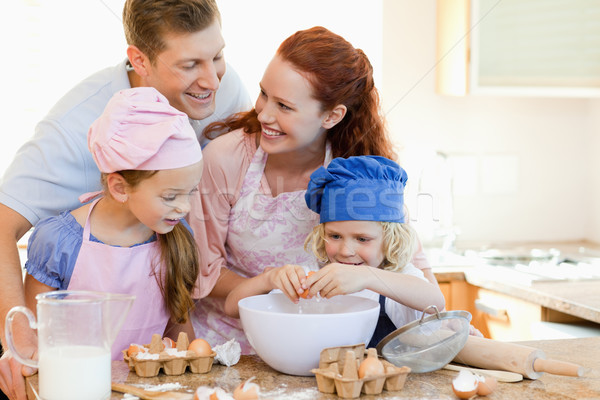 Happy young family enjoys baking together Stock photo © wavebreak_media