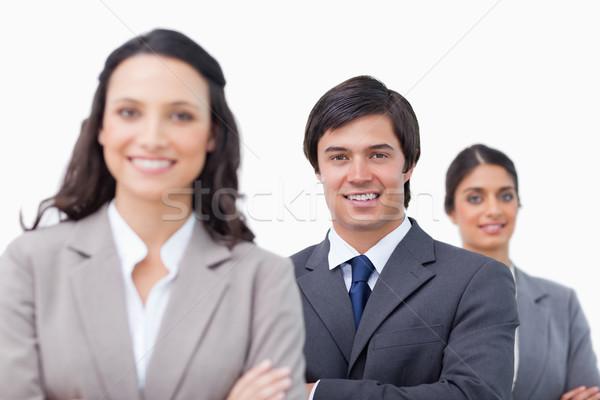 Glimlachend jonge armen gevouwen witte Stockfoto © wavebreak_media