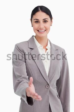 Sonriendo mujer de negocios ofrecimiento mano blanco negocios Foto stock © wavebreak_media