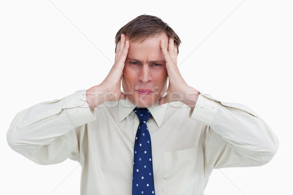 Close up of businessman experiencing a headache against a white background Stock photo © wavebreak_media