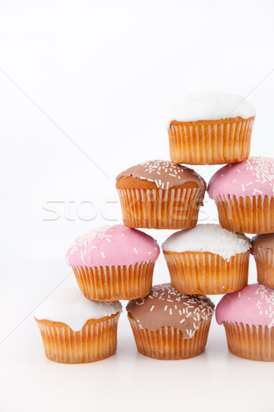 Many muffins with icing sugar placed in pyramid against a white background Stock photo © wavebreak_media